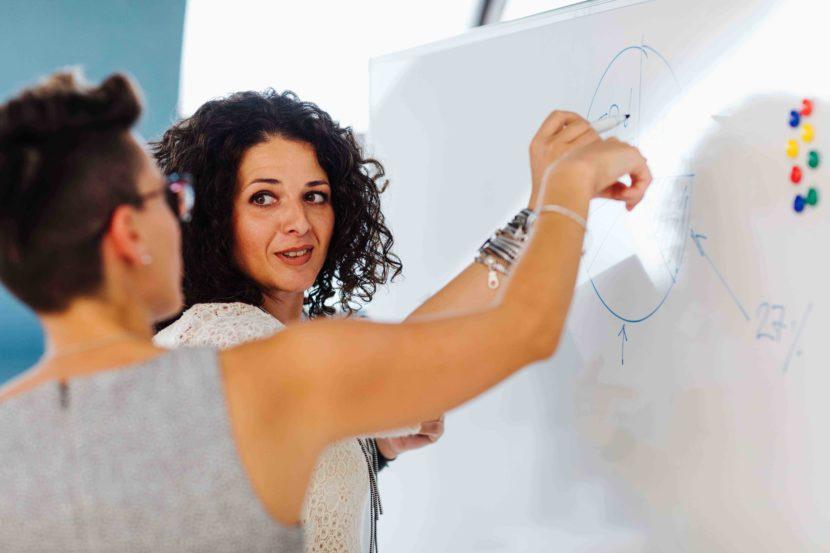 A business woman coaching a colleague
